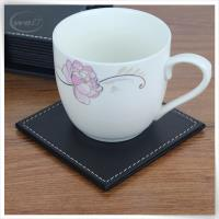 Leather bear coaster in black